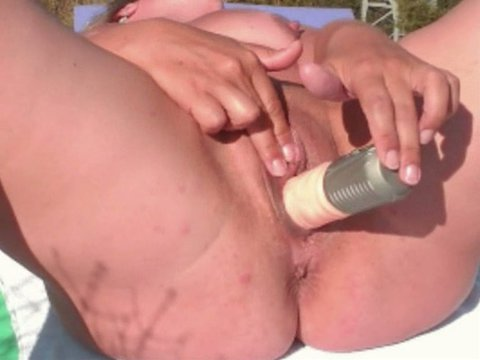 Mature masturbating both holes outdoor