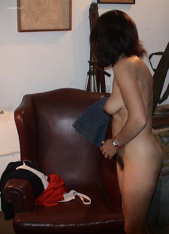 Brunette Mistress Sitting On Top Of Her Vibrating Dildo Stuck On Furniture