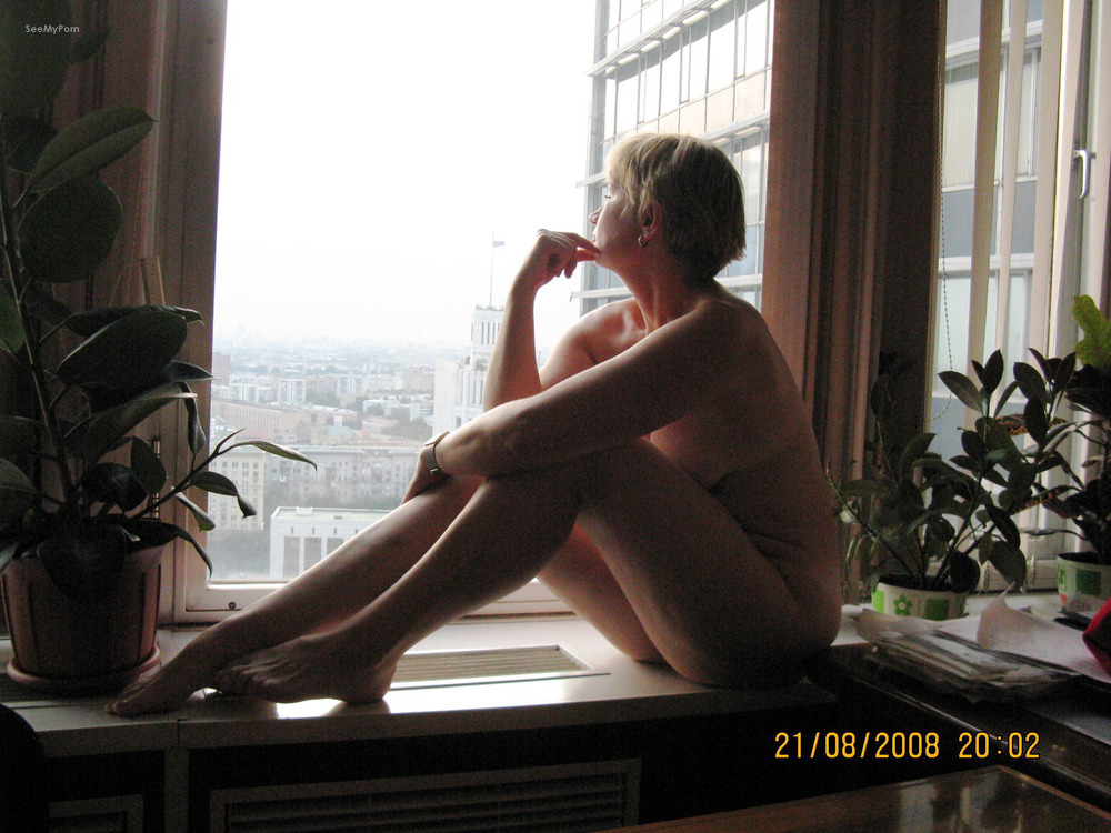 Mature wife nude in the window